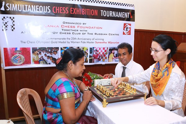 Mrs. Anastasia Khokhlova is seen here making her first move at the exhibition chess match against WFM Suneetha Wijesuriya at the Inaugural function held at the Russian Centre. Watched by Mr. Buddhapriya Ramayake, CEO of the Russian Centre in Colombo.
